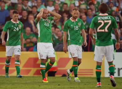 The Irish players look dejected after conceding a goal.