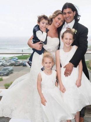 Bobby and Ausra Matharu with their three children.