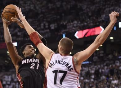 Toronto Raptors' Jonas Valanciunas stops Miami Heat's Hassan Whiteside during overtime.
