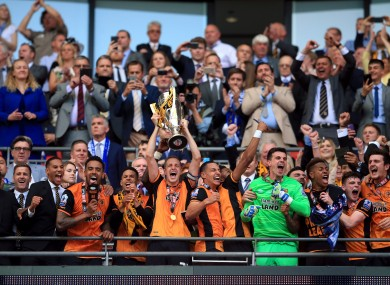 Hull captain Michael Dawson lifts the trophy.
