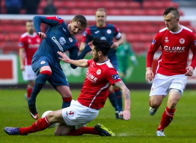 Goalscorer Sadlier, pictured her being tackled by Darren Dennehy of St Patrick's Athletic (file photo).
