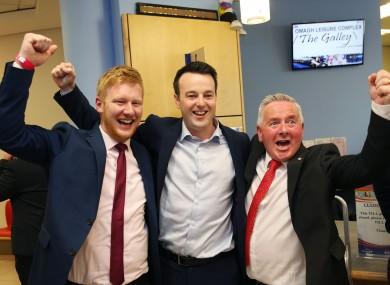 SDLP leader Colum Eastwood (centre) celebrates with newly elected SDLP MLA's Daniel McCrossan, (left) and Richie McPhillips