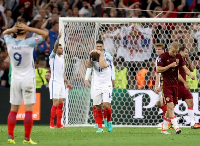 England's Jack Wilshere (centre) stands dejected with team-mates after seeing his side concede their first goal.