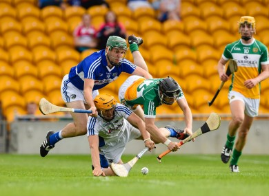 Offaly's Kevin Connolly is battles for possession with Laois goalkeeper Enda Rowland.