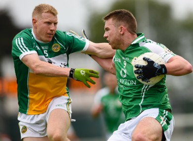 Offaly's Niall Darby and London's Liam Gavaghan in opposition today.