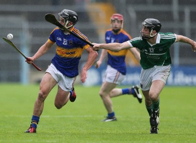 Tipperary's Conor Hammersley and Limerick's Richie English.