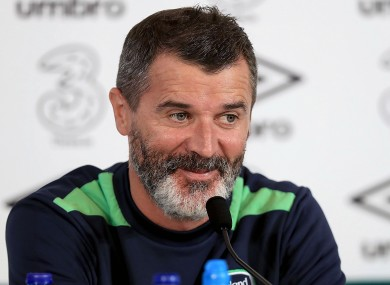 Keane shares a joke with the media.
