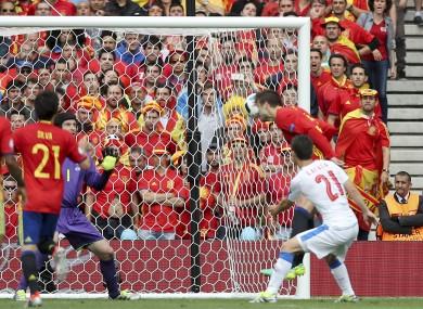 Gerard Pique heads home Andres Iniesta's cross.
