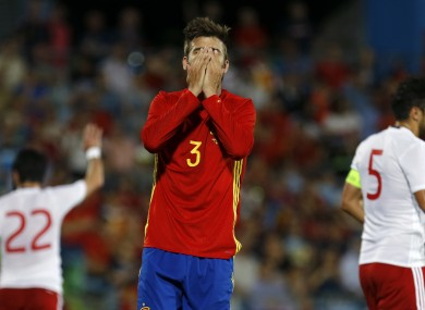 Spain's Gerard Pique covers his face after missing a chance during this evening's defeat to Georgia.