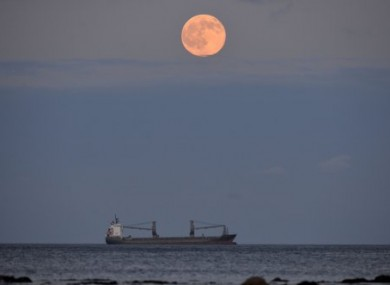 The full moon, known as the strawberry moon, rises near Whitley Bay in England earlier this month.