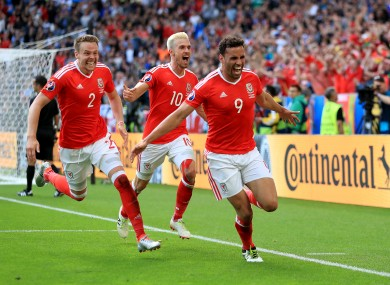 Wales' Hal Robson-Kanu (right) celebrates scoring his side's second goal.