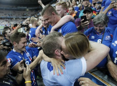 Iceland's players celebrate with fans at the end of the Euro 2016 round of 16 match against England.