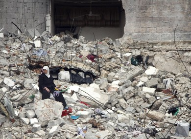 2013 file photo of ruins following an airstrike in Aleppo.