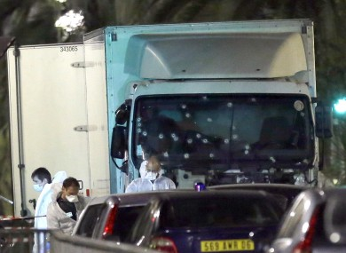 Forensic officers at the truck which ploughed through a Bastille Day crowd in Nice, France, killing at least 80 people.