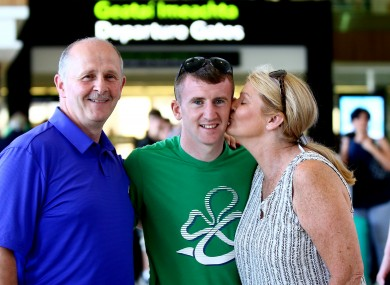 Barnes with his parents Paddy and Ellen at Dublin Airport before departing for Brazil.
