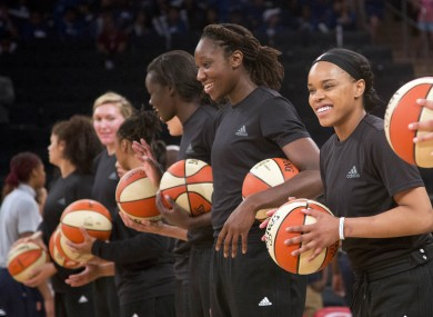 In this Wednesday, 13 July, 2016 file photo, members of the New York Liberty basketball team await the start of a game against the Atlanta Dream in New York. The WNBA is withdrawing its fines for teams and players that showed support of citizens and police involved in recent shootings by wearing black warmup shirts before and during games. WNBA President Lisa Borders said in a statement Saturday, 23 July, the league was rescinding penalties given to the Indiana Fever, New York Liberty, Phoenix Mercury and their players for wearing the shirts.