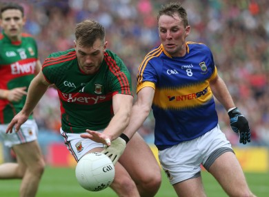 Peter Acheson in action today for Tipperary against Mayo's Aidan O'Shea.
