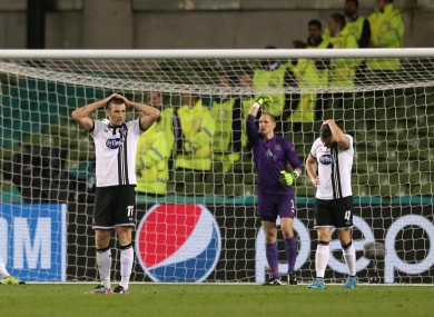 Dejected Dundalk players after Legia's second goal.