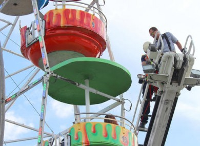 Members of the Greeneville Fire Department help people off the Ferris wheel at the Greene County Fair.
