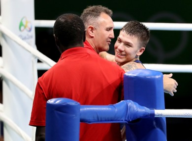 Billy Walsh celebrates Team USA's first boxing medal of the Rio Olympics with his fighter Nico Hernandez.