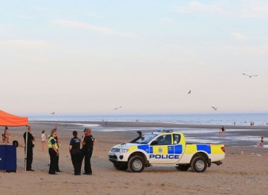 Police at the beach yesterday