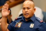 Police in Philippines tell drug users to kill dealers and burn their homes
