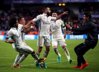 Match-winner Carvajal celebrates with Real Madrid team-mates.