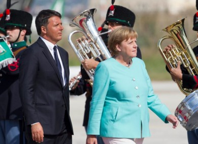 Italian Premier Matteo Renzi and German Chancellor Angela Merkel at Naples' Capodichino international airport today.