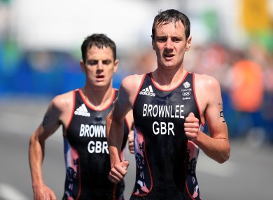 Alistair Brownlee and Jonathan Brownlee on the run leg of the triathlon.