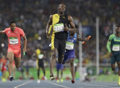 Jamaica's Usain Bolt, centre, competes in the men's 4x100-metre relay final.