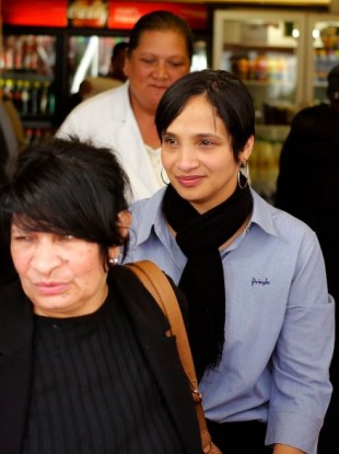 Celeste Nurse, centre, the biological mother of Zephany Nurse, smiles after court proceedings in Cape Town, South Africa, today.
