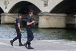 French police officer stabbed as authorities foil attack by three women