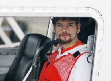 Nathan Carman arrives in a small boat at the US Coast Guard station on Tuesday in Boston after spending a week at sea.