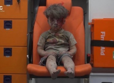 Five-year-old Omran Daqneesh sits in an ambulance after being pulled out of a building hit by an airstirke, in Aleppo.