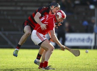 Ballygunner's Barry Coughlan and Passage's Eoin Kelly battle for possession.