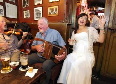 Bride Kaniah Cusack after her wedding to Matthew Farrell in O'Donoghue's pub on Baggot St, Dublin. (September 2015)