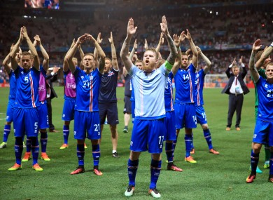 Iceland captain Aron Gunnarsson and his team-mates celebrate after defeating England in France back in June.