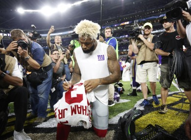 New York Giants wide receiver Odell Beckham autographs his jersey after an NFL football game against the Minnesota Vikings.