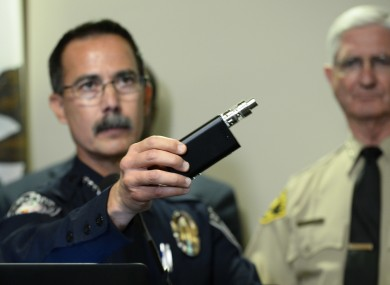 El Cajon Police Department Captain Jeffery Davis holds up a vape device similar to the one that they claim that Alfred Olango was holding when he was shot.