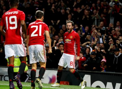 Manchester United's Juan Mata (right) celebrates after scoring his side's first goal during the EFL Cup, round of 16 match at Old Trafford.