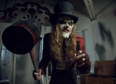 Charlie Chopper, the ringleader of The Nightmare Realm performance group.