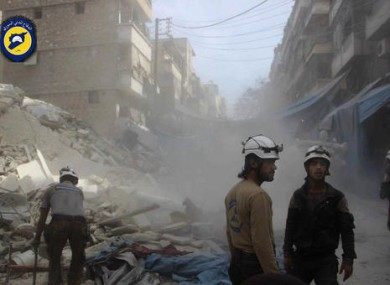 Syrian Civil Defense workers search through the rubble in rebel-held eastern Aleppo.