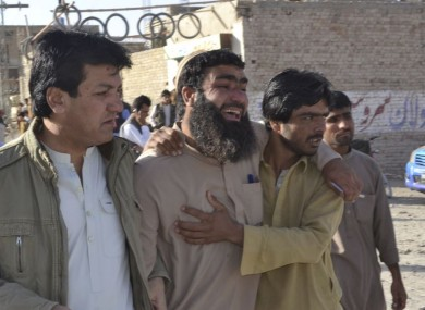 Family members of victims visit a police training centre where gunmen opened fire in Quetta.