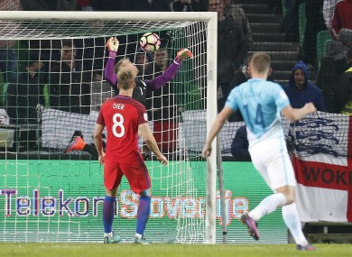 Joe Hart makes a save for England.