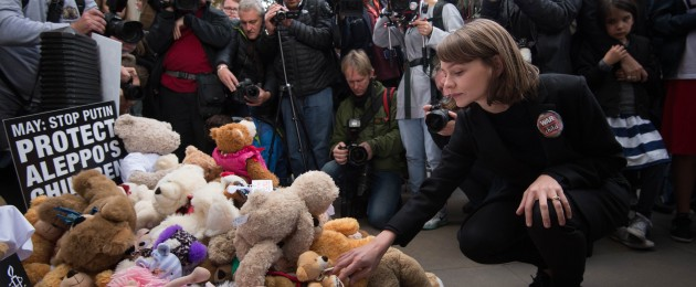 Actress Carey Mulligan leaves a teddy bear outside the gates of Downing Street in central London during a protest to highlight the high numbers of children killed in bombings in Syria and to demand the Government intervene over Russian and Syrian bombing campaigns.