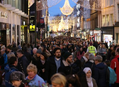 Crowds shop under last year's Grafton Street lights.