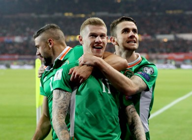 James McClean celebrates with Jonathan Walters and Robbie Brady after scoring Ireland's winner against Austria earlier this month.