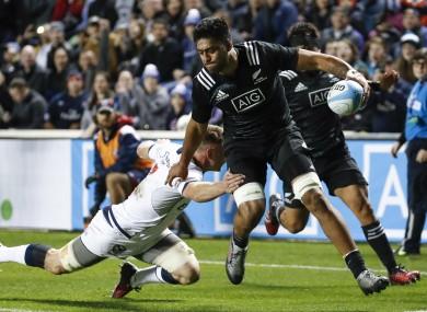 Akira Ioane of the Maori All Blacks scores despite the best efforts of  USA's Tony Lamborn.