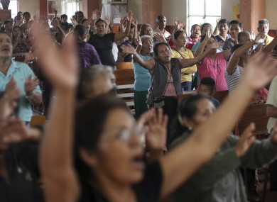 Parishioners celebrate after the news that Rev. Jose Luis Sanchez Ruiz has been found alive, at a his church in Catemaco