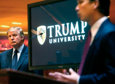 In this May, 2005 file photo, then real estate mogul and reality TV star Donald Trump, left, listens as Michael Sexton introduces him at a news conference in New York where he announced the establishment of Trump University.